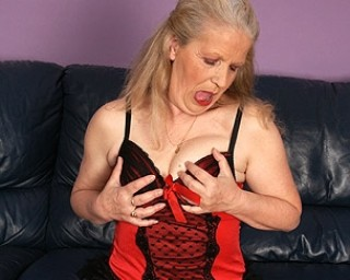 Horny mature slut masturbaying on the couch