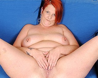 Chubby red mature slut playing with her pussy