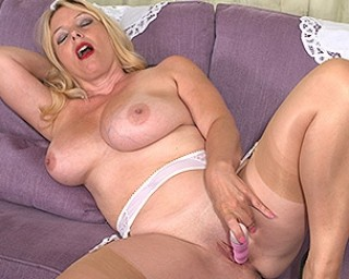 Big breasted MILF getting wet and horny