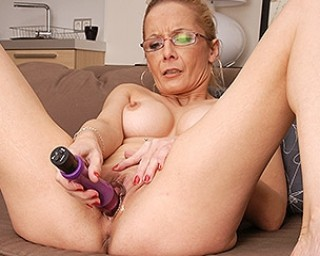 Naughty shaved housewife playing with her toy