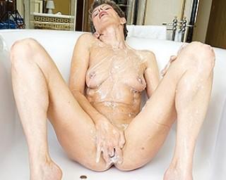 Horny housewife taking a very naughty bath