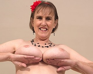 Horny British mature woman playing with her unshaved pussy and her round natural tits