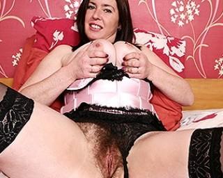 Hairy British mom showing off her nice tits and masturbating