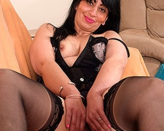 Naughty British housewife playing on her couch