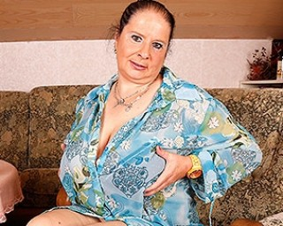 Huge breasted German mature lady playing with herself at home