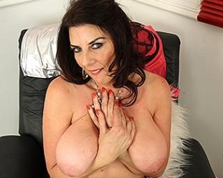 Big breasted British mature slut getting very naughty