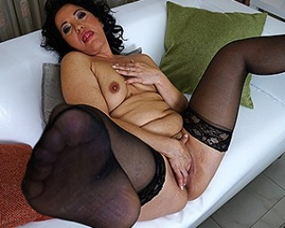 Horny mature slut playing on the couch