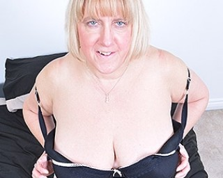 Huge breasted British housewife playing with herself