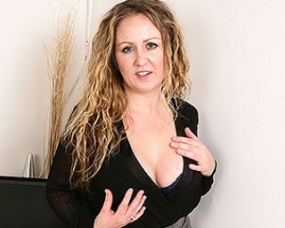 Naughty British mom with lovely tits playing alone