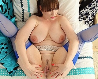 This hot British mom plays with her firm boobs and pussy