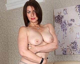This hairy MILF loves to play with herself