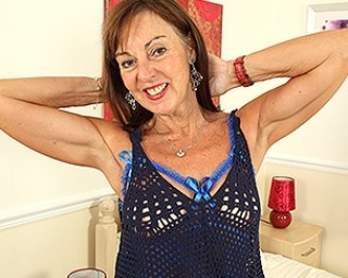 Horny British mature slut playing with her pussy