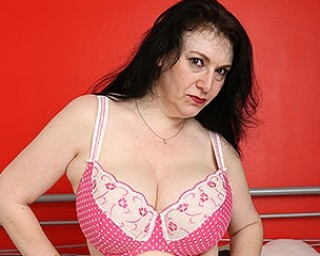 Big breasted British housewife pleasing her pussy