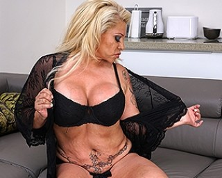 big breasted Spanish housewife playing with her pussy