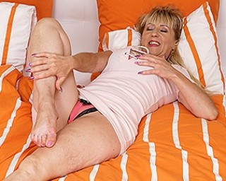 Naughty housewife masturbating in bed
