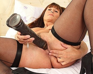 Hot British mom playing with a big dildo