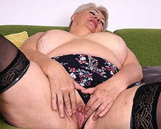 Chubby mature slut playing with her big tits