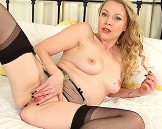Naughty British MILF playing with her shaved pussy