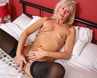 Naughty British housewife masturbating in her bed