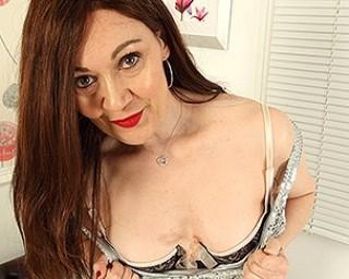 Naughty housewife Kitty Cream getting herself wet