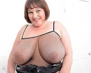 Huge breasted Carol Brown playing with all her toys