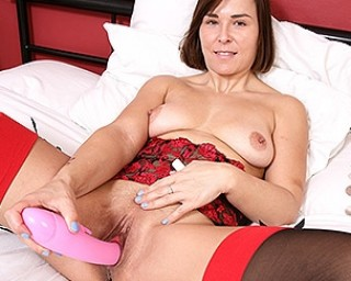 Naughty Mom playing with her wet pussy in bed