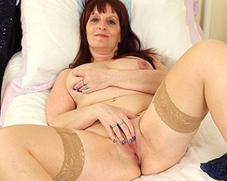 Naughty housewife playing with her wet pussy