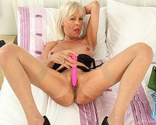Naughty mature slut playing with her toy