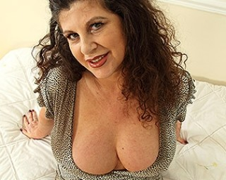 Big breasted British Temptress playing with herself