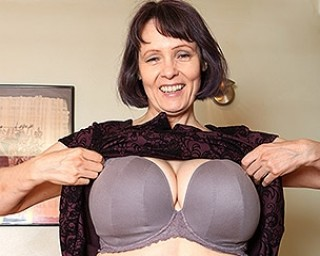 Big breasted British temptress playing with her pussy