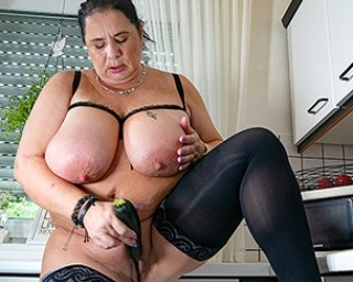 Huge breasted mature slut playing with her pussy in the kitchen