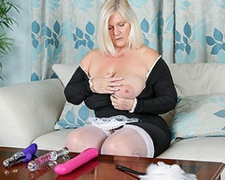 Busty mature maid tries out several toys once the work is done
