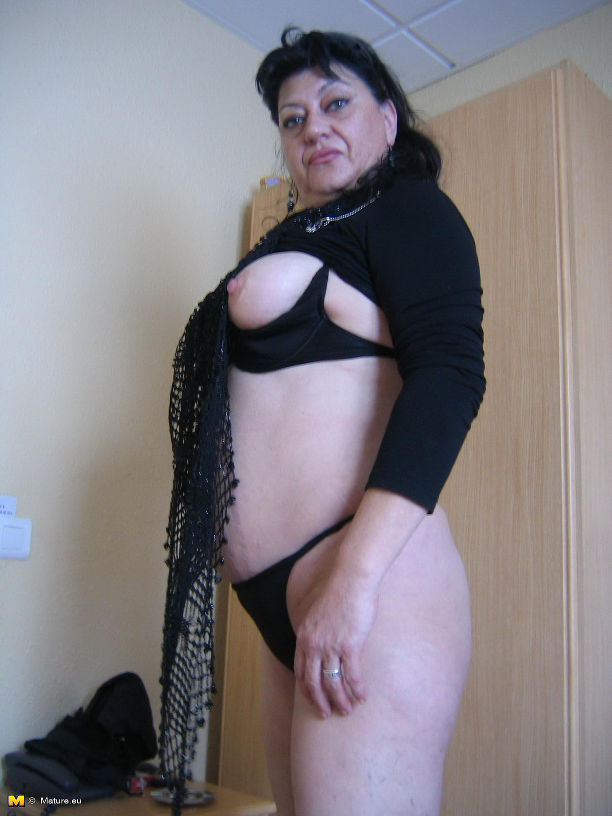 Woman sensuous in black satin fetish