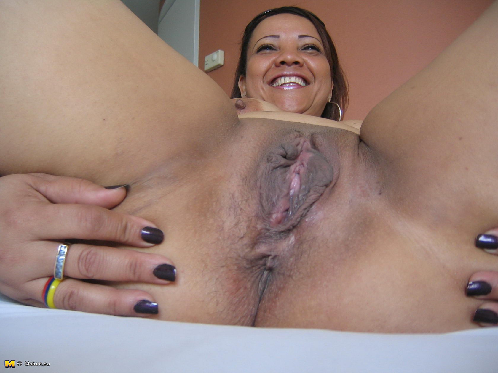 A horny latina with natural big tits sucks two huge cock on the fireplace 8