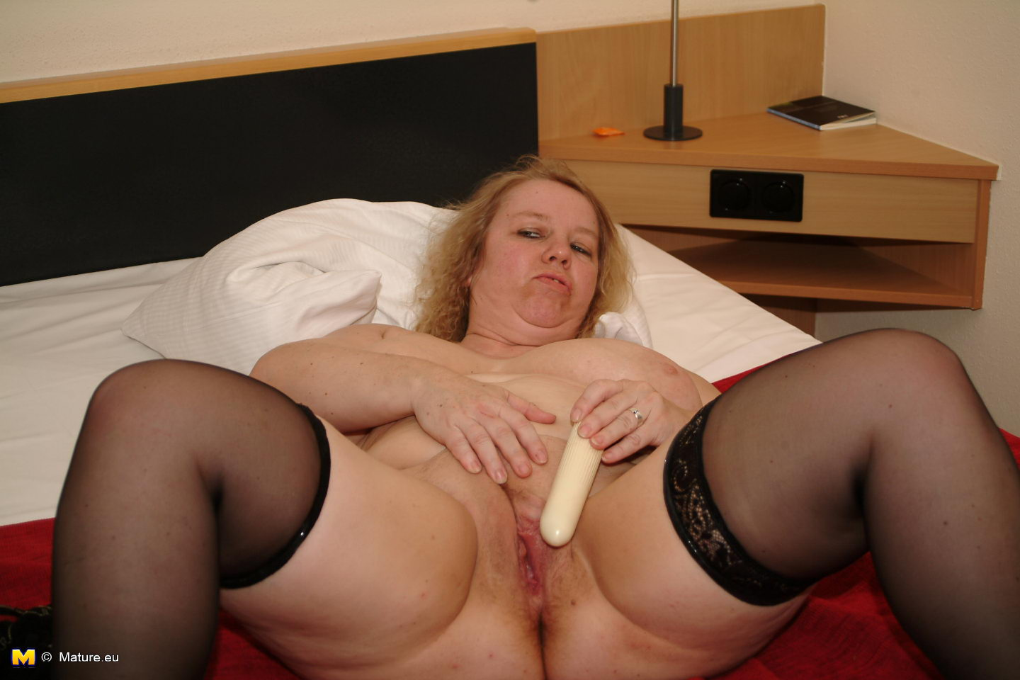 Huge titted mature toying in stockings