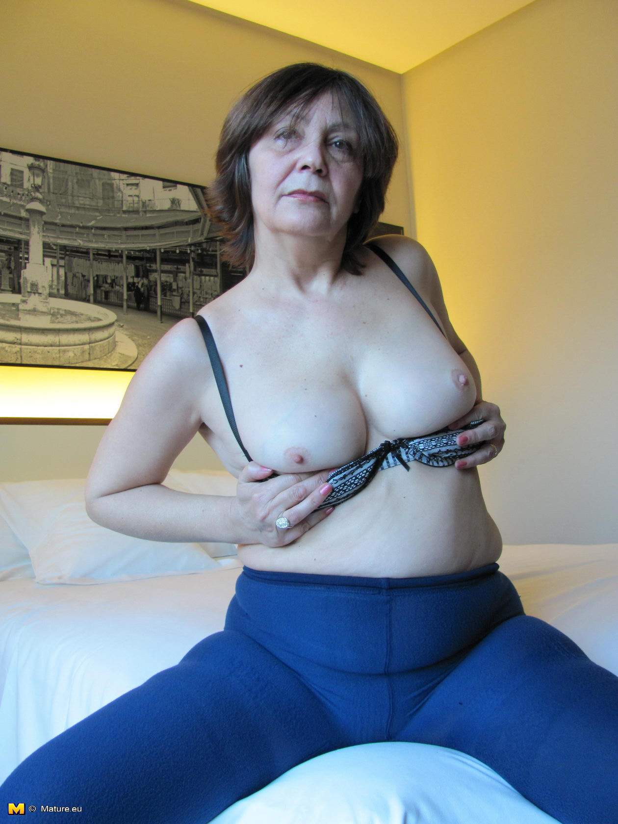Horny milf alone with her dildo