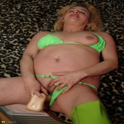 Wet mature slut playing with her toy