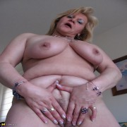 Horny mature slut pleasing herself with a toy