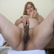 Chubby mama playing with a big dildo