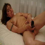 Ltes see what this mature slut does with a rubber dong