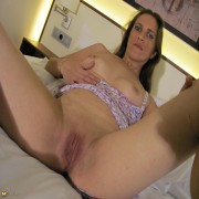 Naughty housewife Norma plays with her dildo
