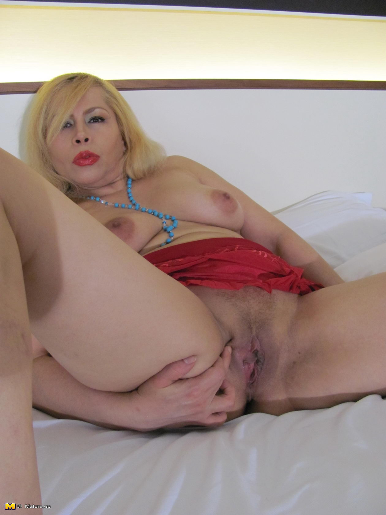 Mature blonde playing with her pussy casually