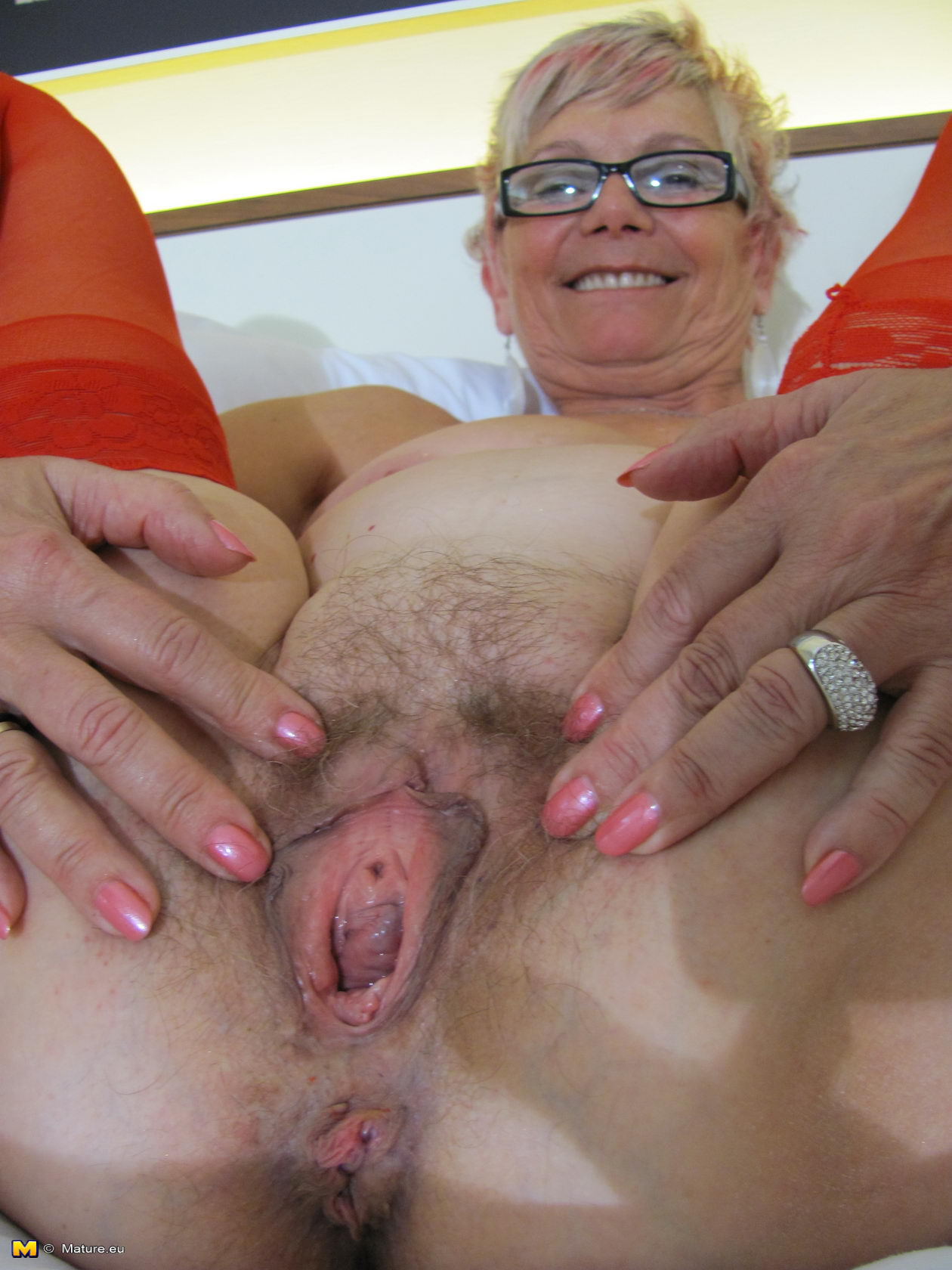image Granny gets her hairy hole filled with two cocks