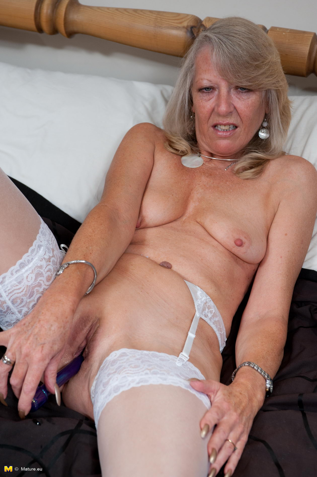 Young boy playing with grannys slut the