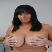 Chubby mature slut playing with her pussy