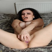 Horny housewife giving herself an orgasm
