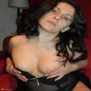 This brunette housewife loves playing with her pussy