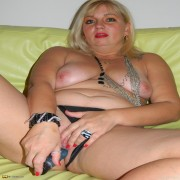 Horny blonde mature slut playing on the couch