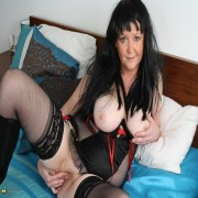 Big mature slut showing her stuff on the couch