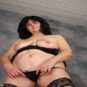 Check out this horny mature slut play all alone
